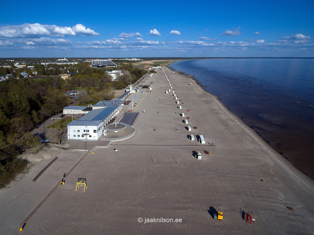 Dressing cabins  in row on empty sandy Pärnu beach in Estonia. Aerial waterfront.