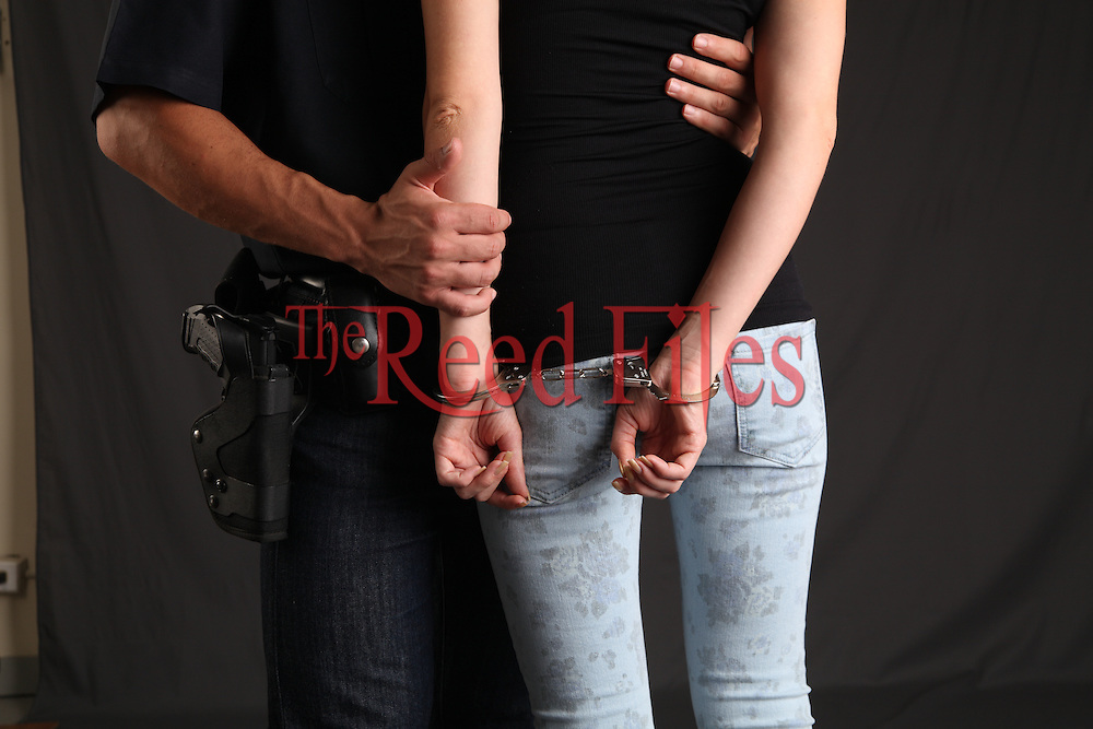 Arresting Police man and a contemporary woman