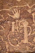 See ancient petroglyphs on Petroglyph Point Trail, which begins from Spruce Tree House on Chapin Mesa in Mesa Verde National Park, Colorado, USA. The park protects some of the best-preserved Ancestral Puebloan archaeological sites in the United States, and was established by Congress and President Theodore Roosevelt in 1906 near the Four Corners region of the American Southwest. Mesa Verde National Park is a UNESCO World Heritage Site. Starting around 7500 BCE, Mesa Verde was seasonally inhabited by nomadic Paleo-Indians. Later, Archaic people established semi-permanent rockshelters in and around the mesa. By 1000 BCE, the Basketmaker culture emerged from the local Archaic population, and by 750 CE the Ancestral Puebloans had developed from the Basketmaker culture. The Mesa Verdeans survived using a combination of hunting, gathering, and subsistence farming of crops such as corn, beans, and squash. They built the mesa's first pueblos sometime after 650, and by the end of the 1100s began building massive cliff dwellings. By 1285, following a period of social and environmental instability driven by a series of severe and prolonged droughts, they abandoned the area and moved south into what is today Arizona and New Mexico.