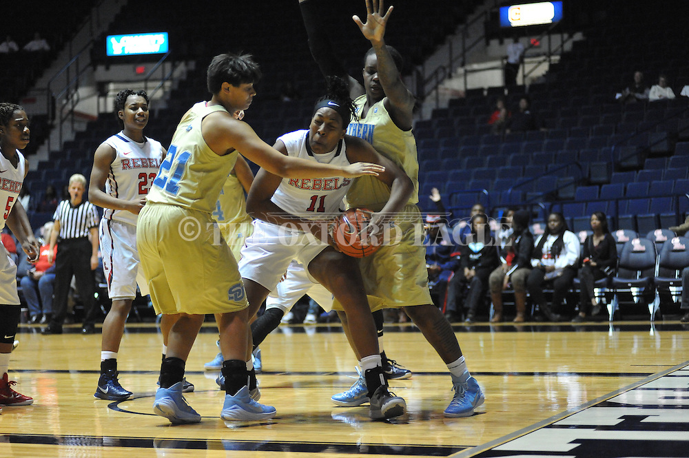 "Ole Miss forward Shequila Joseph (11) vs. Southern University Jaguars guard Quitesha Scott (11) at the C.M. ""Tad"" Smith Coliseum in Oxford, Miss. on Thursday, November 20, 2014. (AP Photo/Oxford Eagle, Bruce Newman)"