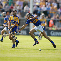 Clare's Pat Vaughan has his shot blocked by Tipperary's James Woodlock during their Munster Senior Hurling Championship Semi-Final clash in the Gaelic Grounds in Limerick on Sunday.<br /> Photograph by Yvonne Vaughan.