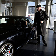 A Russian man and woman look at a Porsche in a showroom in Tyumen. The Siberian city is enjoying a flush of cash from its oil and gas reserves.