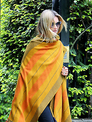 Supermodel Kate Moss wrapped in a blanket and wearing a pair of brown clogs as she leaves her house in London, UK. 15/05/2014<br />BYLINE MUST READ : JAMESY/GOTCHA IMAGES<br /><br />Copyright by © Gotcha Images Ltd. All rights reserved.<br />Usage of this image is conditional upon the acceptance <br />of Gotcha Images Ltd, terms and conditions available at<br />www.gotchaimages.com