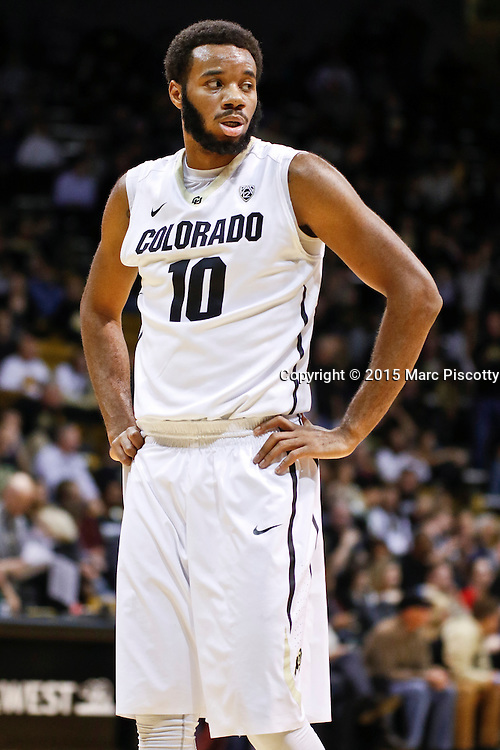 SHOT 1/22/15 10:14:30 PM - Colorado's Tre'Shaun Fletcher #10 during a regular season Pac-12 basketball game against Washington at the Coors Events Center in Boulder, Co. Washington won the game 52-50 on a shot with less than a second to play in the game. (Photo by Marc Piscotty / © 2015)