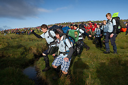 © licensed to London News Pictures. Okehampton, UK  14/05/2011 A group leaps across a stream as thousands of young people take part in the 2011 Ten Tors event on Dartmoor today (Sat). Please see special instructions for usage rates. Photo credit should read London News Pictures