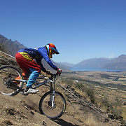 Donovan Isted from Dunedin in action during the NZBNZ South Island Downhill Cup mountain bike downhill series held on The Remarkables face with a stunning backdrop of the Wakatipu Basin. 150 riders took part in the two day event.  Queenstown, Otago, New Zealand. 9th January 2012. Photo Tim Clayton