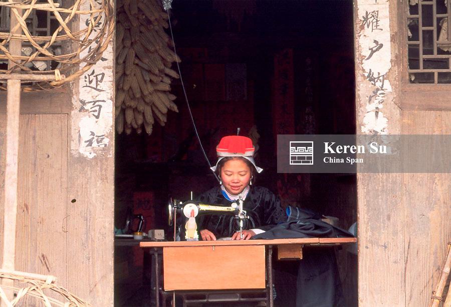 Gejia Miao girl sewing with sewing machine, Matang, Guizhou Province, China