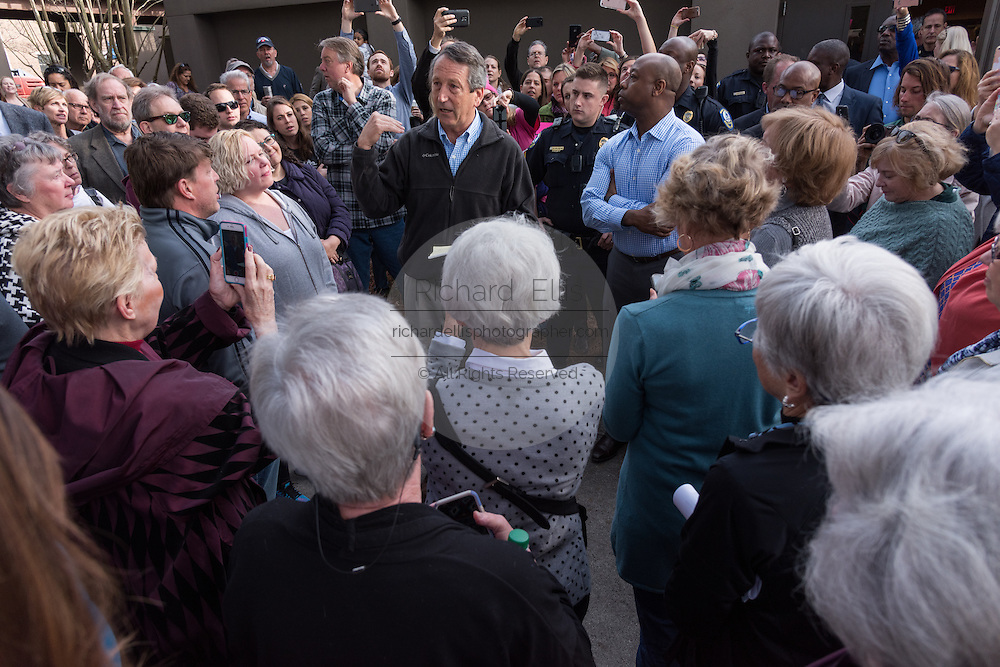 U.S. Rep. Mark Sanford, center, and U.S. Sen. Tim Scott, right, meet with constituents who could not fit into a town hall meeting to solutions February 18, 2017 in Mount Pleasant, South Carolina. Hundreds of concerned residents turned up for the meeting to address their opposition to President Donald Trump during a vocal meeting.