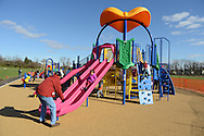 Joe Anderson of Lower Makefield, Pennsylvania catches Taylor Anderson, 4, as she slides down the sliding board after the dedication of Noah's Playground  Saturday November 14, 2015 in Newtown, Pennsylvania. Noah's Playground, a project 5 years in the making is named for Noah Cohen, the son of Newtown Township residents Natalie and Jason Cohen who died in 2010 at age two months of Sudden Infant Death Syndrome. (Photo by William Thomas Cain)