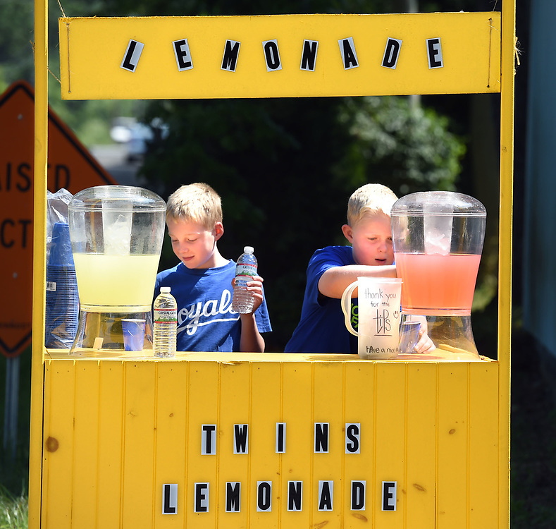 (Mara Lavitt &mdash; New Haven Register) <br /> August 4, 2014 Mad, left, and Justin Bailey, age 11 of the Ivoryton section of Essex, have set up their well-appointed lemonade stand outside their father Jeff's business, the Madison Ice House. The two are saving the sales from two different lemonades as well as water, to purchase a tandem bicycle.<br /> mlavitt@newhavenregister.com