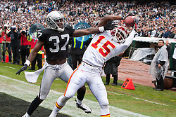 November 7, 2010; Oakland, CA, USA;  Kansas City Chiefs wide receiver Verran Tucker (15) catches a pass for a touchdown in front of Oakland Raiders cornerback Chris Johnson (37) during the second quarter at Oakland-Alameda County Coliseum.