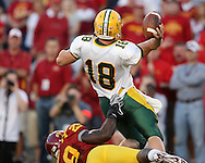 September 3, 2009: North Dakota State quarterback Nick Mertens (18) throws the ball away as he is pulled down by Iowa State defensive tackle Rashawn Parker (29) during the first half of the Iowa State Cyclones' 34-17 win over the North Dakota State Bison at Jack Trice Stadium in Ames, Iowa on September 3, 2009.