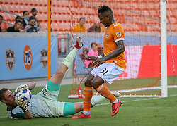 July 18, 2018 - Houston, TX, U.S. - HOUSTON, TX - JULY 18:  Sporting Kansas City goalkeeper Tim Melia (29) traps the ball, denying Houston Dynamo forward Romell Quioto (31) a chance to score during the US Open Cup Quarterfinal soccer match between Sporting KC and Houston Dynamo on July 18, 2018 at BBVA Compass Stadium in Houston, Texas. (Photo by Leslie Plaza Johnson/Icon Sportswire) (Credit Image: © Leslie Plaza Johnson/Icon SMI via ZUMA Press)