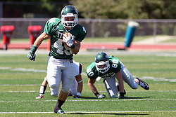 08 September 2012:  Cameron Blossom breaks free and runs for significant yardage during an NCAA division 3 football game between the Alma Scots and the Illinois Wesleyan Titans which the Titans won 53 - 7 in Tucci Stadium on Wilder Field, Bloomington IL