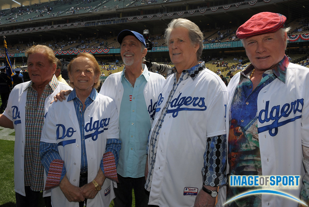 Apr 10, 2012; Los Angeles, CA, USA; Recording artists from the Beach Boys at the 2012 opening day game between the Pittsburgh Pirates and the Los Angeles Dodgers at Dodger Stadium. From left: Bruce Johnston and Al Jardine and David Marks and Brian Wilson and Mike Love.