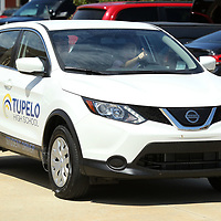 Alyssa Williams, an eleventh grader at Tupelo High School, points for directions, as she drives out of the school parking lot with Harris Faucette, Driver's Ed instructor, in one of the school's two new Nissan Rouge's on Thursday.