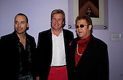 David furnish, Theo Fennell and Sir Elton John, Theo Fennell party to celebrate their 21st Anniversary. The Collection. 28 October 2003. © Copyright Photograph by Dafydd Jones 66 Stockwell Park Rd. London SW9 0DA Tel 020 7733 0108 www.dafjones.com