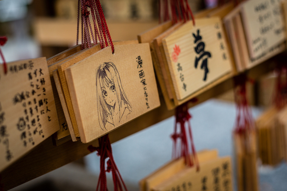 Ema are votive tablets that the pilgrims leave at the temples with their prayers. Some are quite original and feature manga characters.