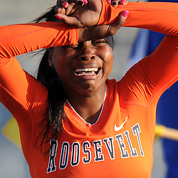 Roosevelt's Jasmyne Graham reacts after hitting a hurdle and finishing last in the 100 hurdles during the CIF-SS Masters Meet at Cerritos College on Friday, May 24, 2013 in Norwalk, Calif.
