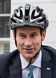 © Licensed to London News Pictures. 27/06/2017. London, UK. Health Secretary Jeremy Hunt leaves home by bicycle. Mr Hunt is facing criticism over the amount of time it took him to inform Parliament about a clerical blunder that allowed 700,000 letters to NHS patients to go missing. Photo credit: Peter Macdiarmid/LNP