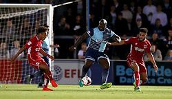 Adebayo Akinfenwa of Wycombe Wanderers holds up the ball against Derrick Williams of Bristol City and Bobby Reid of Bristol City - Mandatory by-line: Robbie Stephenson/JMP - 09/08/2016 - FOOTBALL - Adams Park - High Wycombe, England - Wycombe Wanderers v Bristol City - EFL League Cup