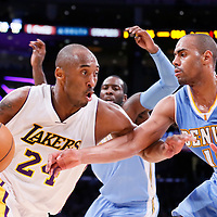 23 November 2014: Los Angeles Lakers guard Kobe Bryant (24) drives past Denver Nuggets guard Arron Afflalo (10) during the Los Angeles Lakers season game versus the Denver Nuggets, at the Staples Center, Los Angeles, California, USA.