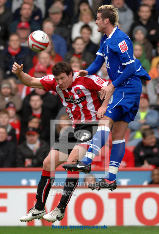 Sheffield - Sunday, March 1st, 2009:  Sheffield United's Darius Henderson and Birmingham City's Frank Queudrue during the Coca Cola Championship match at Bramall Lane, Sheffield. (Pic by John Rushworth/Focus Images)
