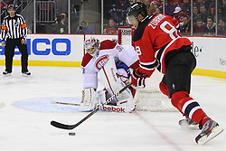 Feb 2; Newark, NJ, USA; New Jersey Devils right wing Dainius Zubrus (8) skates with the puck in front of Montreal Canadiens goalie Carey Price (31) during the second period at the Prudential Center.