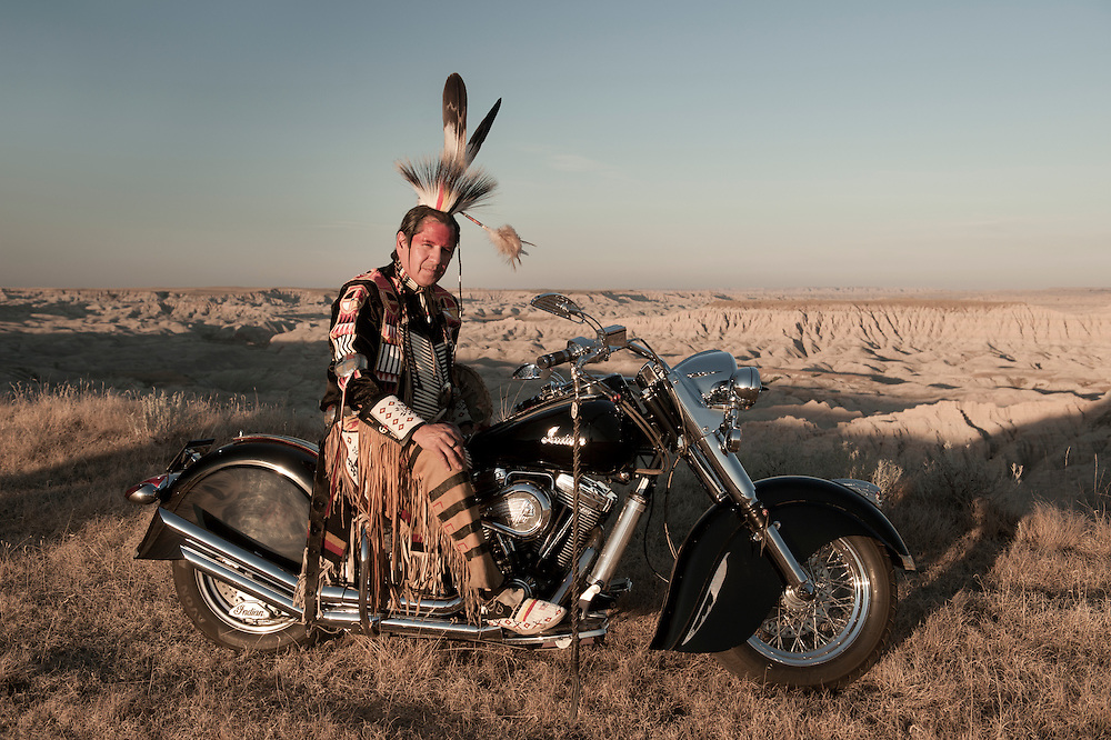 Jim Yellowhawk on his indian bike,,Lakota, South Dakota,USA.(model release)