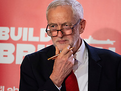Glasgow, UK. 11 May, 2018. Labour Leader Jeremy Corbyn giving a speech in Govan, Glasgow in which he said that a Labour government will proactively support UK shipbuilding as part of a wider industrial strategy and called on the Conservative Government to guarantee three new Royal Fleet Auxiliary vessels will be built in domestic shipyards.