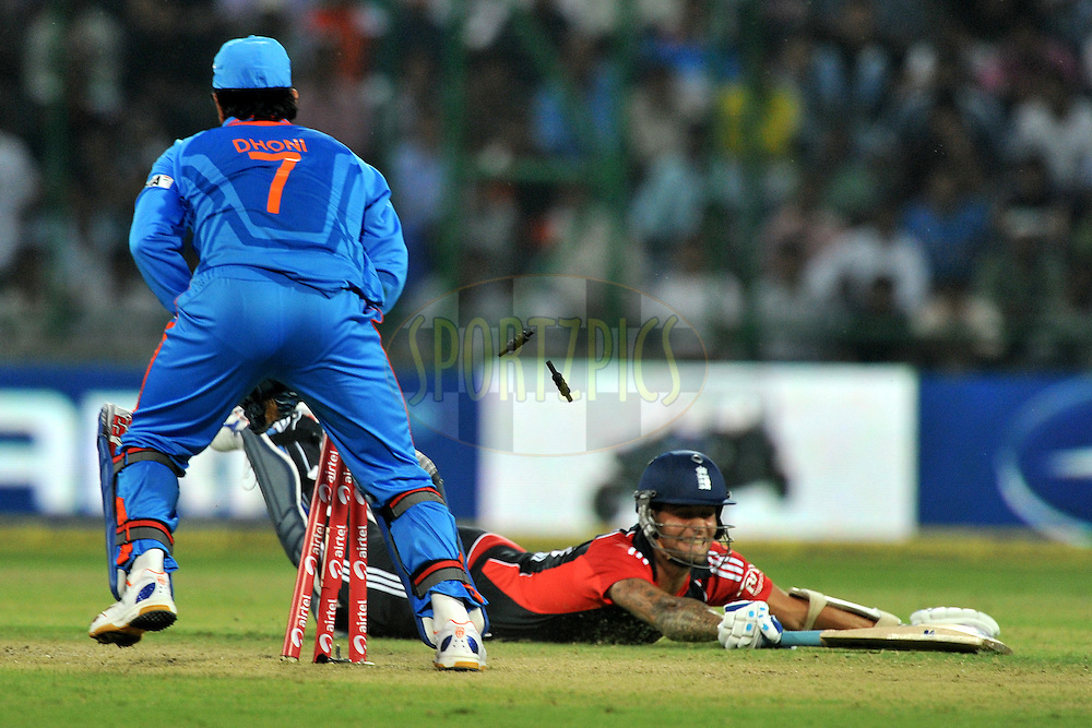 Mahendra Singh Dhoni captain of India  gets Jade Dernbach of England run-out during the 2nd One Day International ( ODI ) match between India and England held at the The Feroz Shah Kotla Stadium, Delhi on the 17th October 2011..Photo by Pal Pillai/BCCI/SPORTZPICS