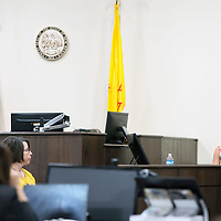 The first witness of the case Julie Gudino, right, answers the first set of questions by the prosecution on Day 1 of the Green Case at the 13th Judicial District Courthouse in Grants Tuesday afternoon.