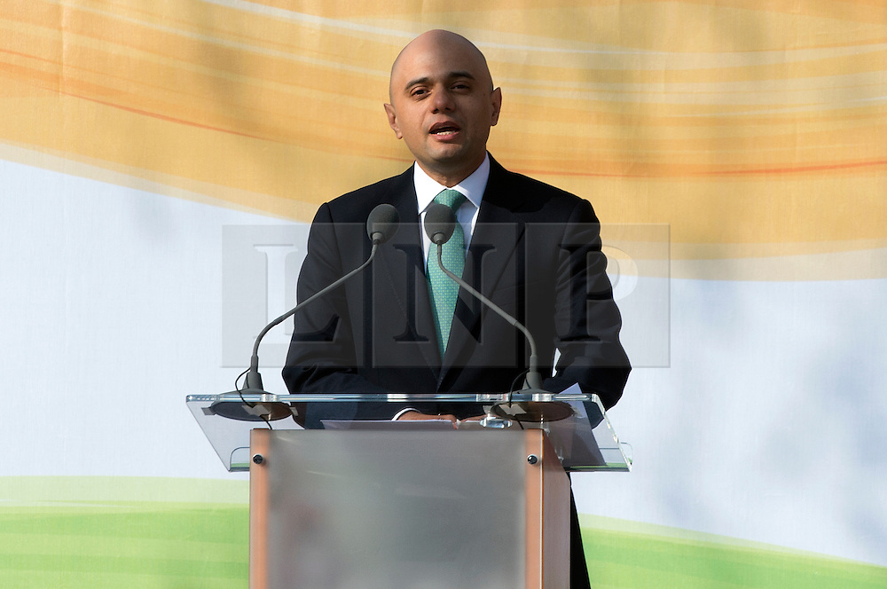 © Licensed to London News Pictures. 14/03/2015. <br /> LONDON, UK. Culture Minister, Sajid Javid speaks at the unveiling of a 9ft-high bronze statue of civil rights leader, Mahatma Gandhi in Parliament Square, central London today. Photo credit: Hannah McKay/LNP