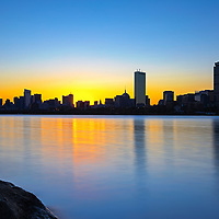 Boston sunrise photograph featuring familiar landmarks along the Charles River, such as the Prudential Center and 200 Clarendon better known as the John Hancock Tower. This Boston skyline photo at the early morning light is available as museum quality photography prints, canvas prints, acrylic prints or metal prints. Fine art prints may be framed and matted to the individual liking and decorating needs:<br />