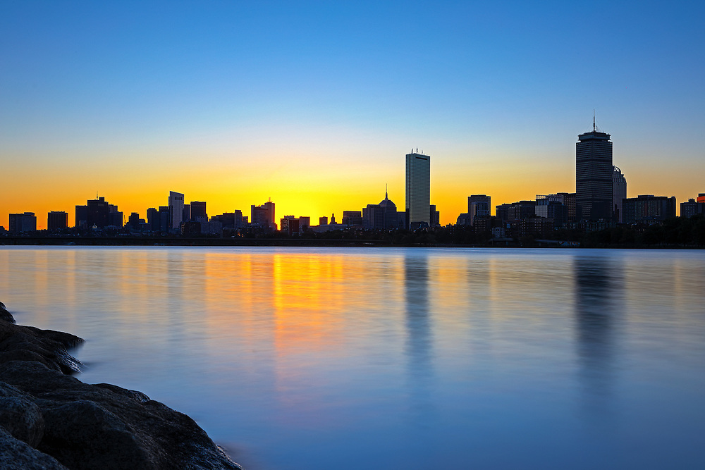 Boston sunrise photograph featuring familiar landmarks along the Charles River, such as the Prudential Center and 200 Clarendon better known as the John Hancock Tower. This Boston skyline photo at the early morning light is available as museum quality photography prints, canvas prints, acrylic prints or metal prints. Fine art prints may be framed and matted to the individual liking and decorating needs:<br />  <br /> https://juergen-roth.pixels.com/featured/boston-charles-river-sunrise-juergen-roth.html<br /> <br /> All Sunrise Boston photos are available for digital and print photography image licensing at www.RothGalleries.com. Please contact me direct with any questions or request.<br /> <br /> Good light and happy photo making!<br /> <br /> My best,<br /> <br /> Juergen<br /> Prints: http://www.rothgalleries.com<br /> Photo Blog: http://whereintheworldisjuergen.blogspot.com<br /> Instagram: https://www.instagram.com/rothgalleries<br /> Twitter: https://twitter.com/naturefineart<br /> Facebook: https://www.facebook.com/naturefineart