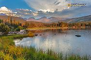 Sunrise light on Hallett Peak and Flattop Mountain above Sprague Lake in Rocky Mountain National Park, Colorado, USA