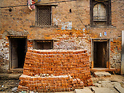 01 MARCH 2017 - KHOKANA, NEPAL: A stack of bricks that will be used to rebuild homes destroyed in the 2015 earthquake in Nepal. Recovery seems to have barely begun nearly two years after the earthquake of 25 April 2015 that devastated Nepal. In some villages in the Kathmandu valley workers are working by hand to remove ruble and dig out destroyed buildings. About 9,000 people were killed and another 22,000 injured by the earthquake. The epicenter of the earthquake was east of the Gorka district.     PHOTO BY JACK KURTZ
