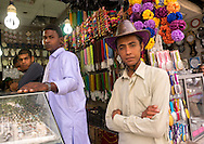Iran, Fars Province, Shiraz, young man from Baluchistan wearing a cow boy hat. The men from Baluchistan area have adopted the cowboy hat as a fashion accessory. The religious authorities are displeased.