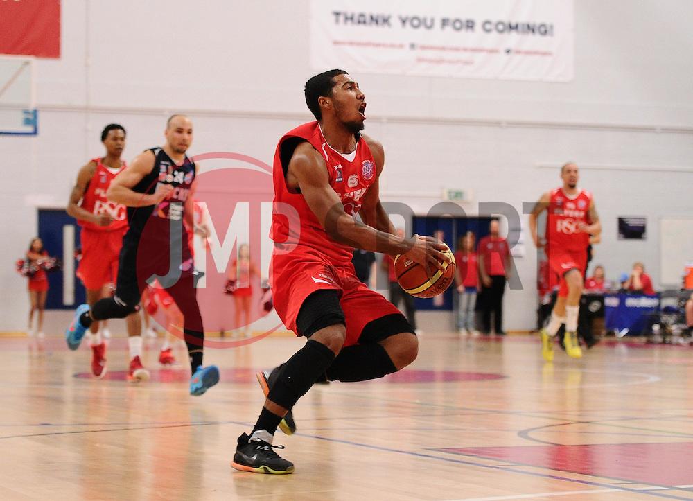 Bristol Flyers' Dwayne Lautier-Ogunleye breaks forward to slam dunk a basket  - Photo mandatory by-line: Joe Meredith/JMP - Mobile: 07966 386802 - 11/04/2015 - SPORT - Basketball - Bristol - SGS Wise Campus - Bristol Flyers v Glasgow Rocks - British Basketball League