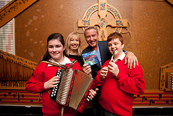 Repro Free: 18/10/2012 .Catherine McGorman, ChildVision Music Teacher and Lord of the Dance, Michael Flatley are pictured with Jasmine Boyle (12) from Finglas and Paul Geoghegan (12) from Tallaght both pupils of ChildVision, the national education centre for blind children, as Michael Flatley launched a unique album of traditional Irish music featuring music made famous by blind musicians and now played by a new generation of sightless players at Woodlock Hall, All Hallows College, Drumcondra. The brainchild of Catherine McGorman the venture was supported by the Arts Council and all funds raised will go to supporting music teaching for blind and partially sighted children at ChildVision. Pic Andres Poveda