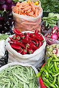 Green chilli and red chillies display for sale at food and spice market in Kadikoy district on Asian side Istanbul, East Turkey
