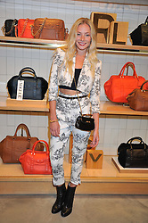 CLARA PAGET at a party to celebrate the launch of the Vogue Fashion's Night Out held at Mulberry, Bond Street, London on 6th September 2012.