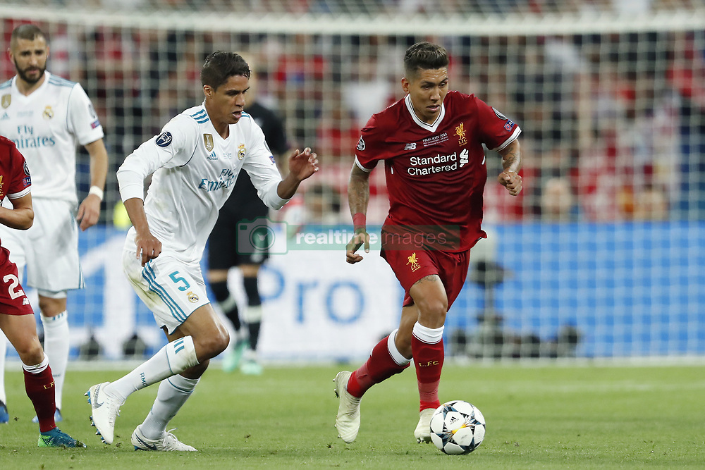 (L-R) Raphael Varane of Real Madrid, Roberto Firmino of Liverpool FC during the UEFA Champions League final between Real Madrid and Liverpool on May 26, 2018 at NSC Olimpiyskiy Stadium in Kyiv, Ukraine