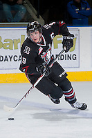 KELOWNA, CANADA -FEBRUARY 5:  Conner Bleackley C #9 of the Red Deer Rebels skates with the puck against the Kelowna Rockets on February 5, 2014 at Prospera Place in Kelowna, British Columbia, Canada.   (Photo by Marissa Baecker/Getty Images)  *** Local Caption *** Conner Bleackley;
