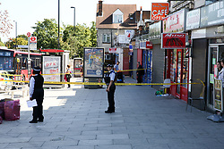 © Licensed to London News Pictures. 14/09/2019. London, UK. Police officers guard a crime scene on Downham Way in Lewisham as a murder investigation has been launched by Met Police after a 34 years old man died in hospital. The victim suffered stab and head wounds on Friday 13 Sept following a fight inside Metro chicken shop on Downham way. A 51 year old man was also injured in the fight and has since been discharged from hospital and subsequently arrested in suspicion murder. Two other men aged 40 and 46 have also been arrested on suspicion murder. Photo credit: Dinendra Haria/LNP