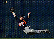 Jonathan Miano/Staff Photographer/Naperville Sun 20090519 Tuesday, Naperville--   Naperville North's Charlie White dives and misses a catch in North's 5-4 win over Naperville Central in extra innings at North Tuesday.