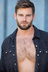 hot man with blue eyes and brown hair in an open shirt