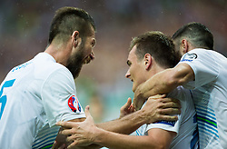 Bostjan Cesar of Slovenia, Nejc Pecnik of Slovenia  celebrate after Pecnik scored second goal for Slovenia during the EURO 2016 Qualifier Group E match between Slovenia and England at SRC Stozice on June 14, 2015 in Ljubljana, Slovenia. Photo by Vid Ponikvar / Sportida