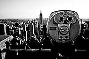 Binoculars on the  Top of the Rock with the Empire State Building in view, Manhattan, New York, 2010.