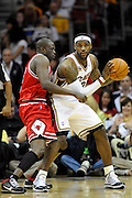 Apr 19, 2010; Cleveland, OH, USA; Cleveland Cavaliers forward LeBron James (23) bumps into Chicago Bulls forward Luol Deng (9) during the third period in game two in the first round of the 2010 NBA playoffs at Quicken Loans Arena. The Cavaliers beat the Bulls 112-102. Mandatory Credit: Jason Miller-US PRESSWIRE